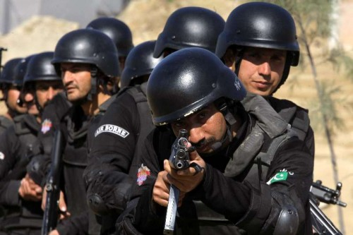 Pakistani police commandos demonstrate their skills during a special elite police training course at a police training centre in northwest Pakistan's Nowshera on Feb. 11, 2015. About 35 female and 150 male commandoes demonstrated skills during a commando training course in Nowshera.