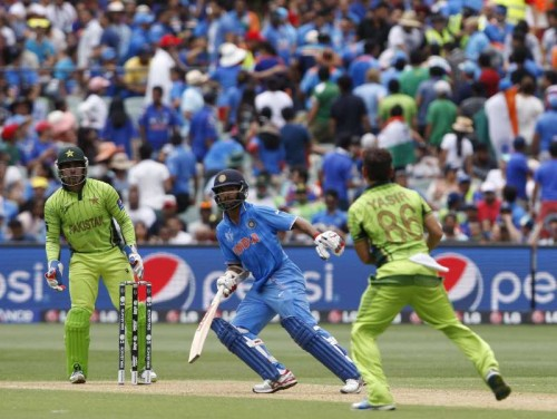 Indian cricketer Shikhar Dhawan in action during an ICC World Cup 2015 match between India and Pakistan at Adelaide Oval in Adelaide, Australia on Feb 15, 2015.