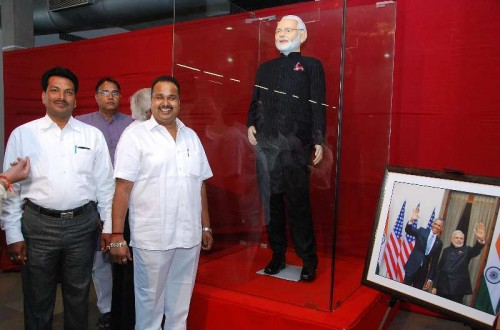 Prime Minister Narendra Modi's `name-striped` suit on display at a charity auction organised in Surat, Gujarat on Feb 18, 2015.