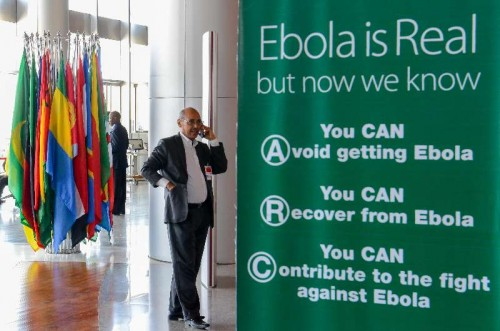A man calls beside a poster with the theme of anti-Ebola Virus at the headquarters of African Union (AU) in Addis Ababa, Ethiopia, Jan. 27, 2014. The 22nd African Union summit is scheduled to be opened here on Jan. 30, 2015.