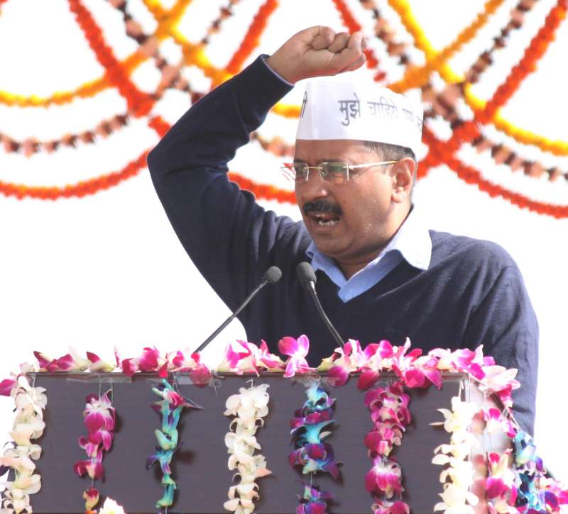 New Delhi: Delhi Chief Minister Arvind Kejriwal addresses public after taking oath at Ramlila Maidan in New Delhi, on Feb 14, 2015. (Photo: Amlan Paliwal/IANS)