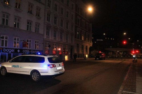 A police vehicle parks near the site of shooting in Copenhagen, Denmark, early Feb. 15, 2015. A shooting occurred near Norreport subway station early Sunday, injuring three people including two policemen. This is the second shooting in the capital city recently after another shooting Saturday night.