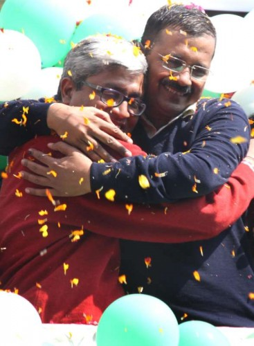 Aam Aadmi Party (AAP) leaders Arvind Kejriwal and Ashutosh celebrate party's performance in the recently concluded Delhi Assembly Polls in New Delhi, on Feb 10, 2015.