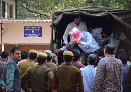 The five people arrested by the Delhi Police for stealing documents and leaking them to corporate houses being taken to be produced before a Metropolitan Megistrate`s court in New Delhi, on Feb 21, 2015. The arrested people include two employees of the petroleum ministry.