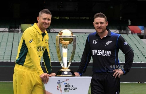 New Zealand ODI team captain Brendon McCullum and Australian ODI team captain Michael Clarke during a photo shoot with the Cricket World Cup trophy at the Melbourne Cricket Ground in Melbourne, Australia, on March 28, 2015.