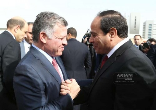 The handout photo from Egypt's state-run news agency MENA shows that Egyptian President Abdel Fattah al-Sisi shakes hands with the visiting Jordan's King Abdullah II upon his arrival to Cairo for talks on terms of anti-terrorism, cooperation in military and security