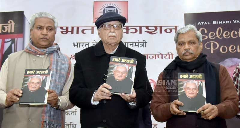 BJP leaders Ram Lal (R) and Prabhat Jha (L) with BJP veteran and party MP from Gandhinagar L K Advani at the launch of `Hamare Atal ji` - a book edited by Jha on former prime minister Atal Behari Vajpayee's 90th birthday in New Delhi