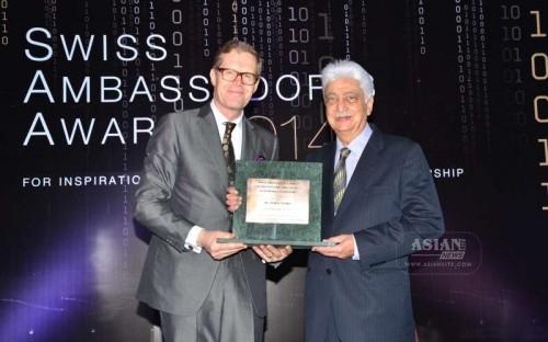 Wipro Chairman Azim Premji receives the Swiss Ambassadors Award from Swiss Ambassador to India Dr. Linus von Castelmur in Mumbai, on Dec 3, 2014.