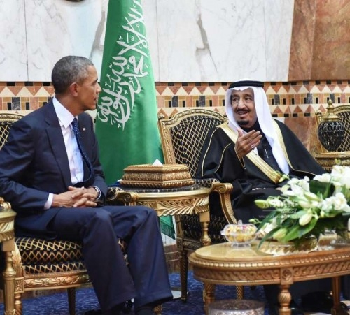 U.S. President Barack Obama talks with Saudi Arabia's King Salman bin Abdulaziz Al Saud(R) after arriving in Riyadh, Saudi Arabia, on Jan. 27, 2015. Obama cut short his visit to India to be able to visit Saudi Arabia to offer his condolences and discuss key regional and international topics.