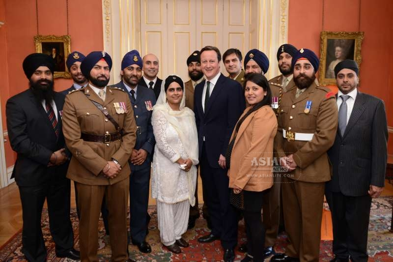 Prime Minister David Cameron with soldiers from the army during a Vaisakhi reception at No 10