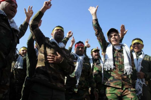 Government-backed Sunni Arab tribesmen from paramilitary groups are reviewed at the end of their training period to fight Islamic State (IS) militants in the Kirkuk, North Iraq, Feb. 26, 2015.