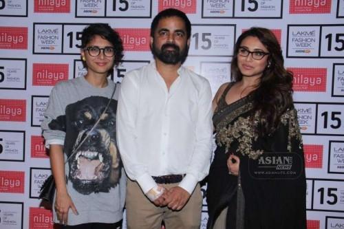 Fashion designer Sabyasachi Mukherjee flanked by filmmaker Kiran Rao and actress Rani Mukerji.