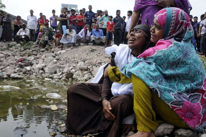 Relatives mourn at the Rana Plaza  site in Bangladesh
