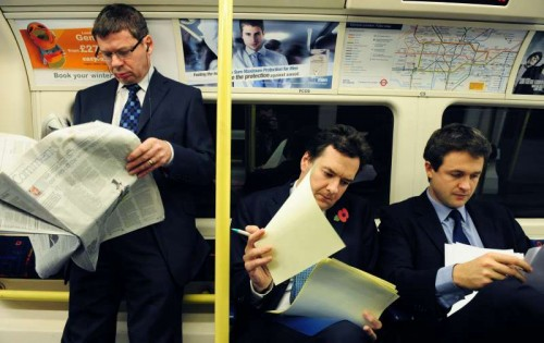 Chancellor George Osborne busy at London Tube