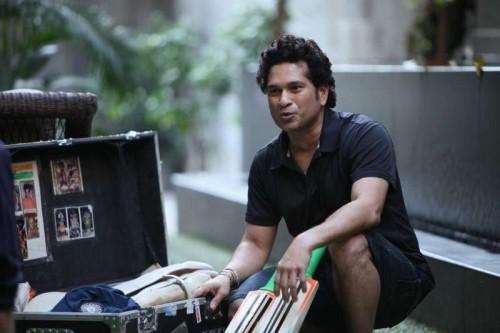 Cricket legend Sachin Tendulkar displays his treasured personal belongings to director James Erskine during the shoot of his Docu-feature film in Mumbai.