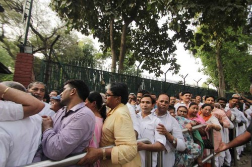 Farmers wait outside Congress chief Sonia Gandhi's residence to meet her, in New Delhi, on April 20, 2015