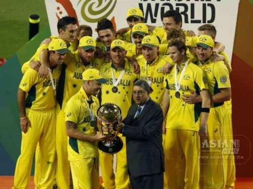 Former BCCI president and current ICC chairman N. Srinivasan hands over the cricket World Cup trophy to Australian captain Michael Clarke at Melbourne Cricket Ground in Australia on March 29, 2015.