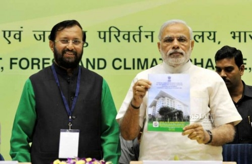 Prime Minister Narendra Modi with the Union Minister of State for Environment, Forest and Climate Change (Independent Charge) Prakash Javadekar addresses at the Conference of State Environment and Forest Ministers in New Delhi on April 6, 2015.