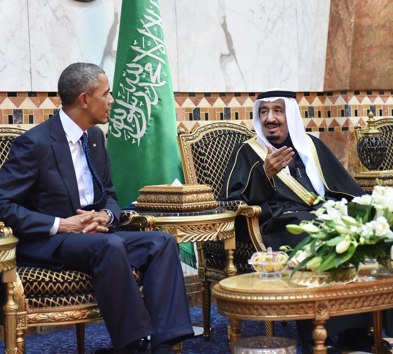U.S. President Barack Obama talks with Saudi Arabia's King Salman bin Abdulaziz Al Saud(R) after arriving in Riyadh, Saudi Arabia, on Jan. 27, 2015. Obama cut short his visit to India to be able to visit Saudi Arabia to offer his condolences and discuss key regional and international topics. FILE PHOTO