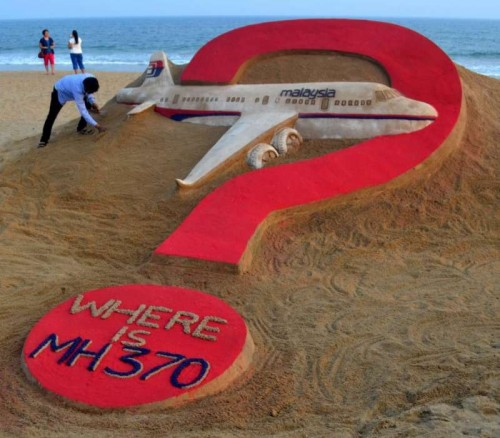 (File photo): Renowned Indian sand artist Sudarsan Pattnaik's creation at Puri beach asks `Where is (Malaysian plane) MH370 ?`