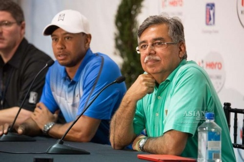 Vice-Chairman and Managing Director of Hero MotoCorp Ltd. Pawan Munjal with company first Global Corporate Partner, Tiger Woods in Orlando, Florida, United States on Dec 2, 2014.