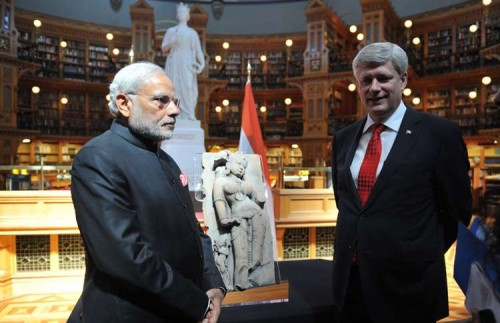 Prime Minister Stephen Harper of Canada returning artefact 'Parrot lady' to Indian Prime Minister Narendra Modi