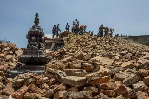 Soldiers and local people clear the debris of damaged buildings in Lalitpur, an ancient city adjacent to Kathmandu, capital of Nepal on May 12, 2015. Lalitpur was damaged seriously in last month's earthquake and following aftershocks.
