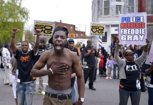 Residents celebrate in west Baltimore, Maryland, the United States, May 1, 2015. Maryland state prosecutor on Friday announced criminal charges against all six Baltimore police officers involved in the death of the 25-year-old black man Freddie Gray.