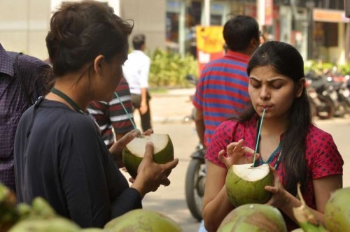 People sip coconut water to beat the heat in Kolkata