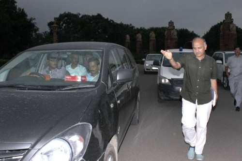 Delhi Chief Minister Arvind Kejriwal and Deputy Chief Minister Manish Sisodia come out of Rashtrapati Bhavan after meeting President Pranab Mukherjee in New Delhi, on May 19, 2015.