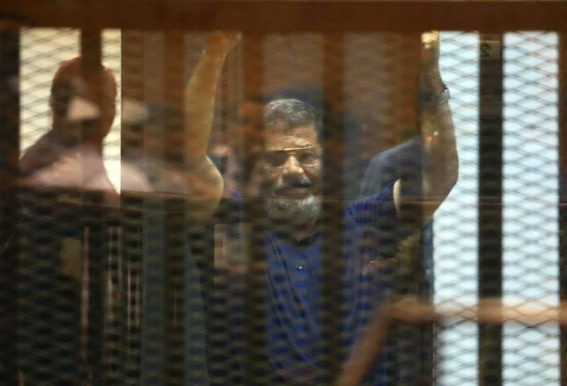 gypt's ousted President Mohamed Morsi waves hands in the defendants' cage on a court in Cairo, Egypt, on May 16, 2015. An Egyptian court sentenced Saturday ousted Islamist president Mohammed Morsi to death over 2011 jailbreak charges.