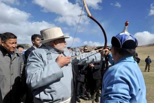 Prime Minister Narendra Modi try his hand on archery at Mini Naadam Festival, in Ulaanbaatar, Mongolia on May 17, 2015.