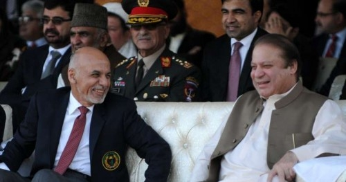 Pakistani Prime Minister Nawaz Sharif (front R) talks with Afghan President Ashraf Ghani (front L) as they watch a cricket match between Pakistan and Afghanistan in Islamabad, capital of Pakistan on Nov. 15, 2014.