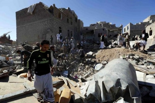 People clear rubbles after a residential neighbourhood was hit by warplanes in Sanaa, Yemen, on May 1, 2015. At least 21 civilians were killed when an overnight air strike by Saudi-led coalition forces mistook its target in the Yemeni capital of Sanaa and hit a populated residential neighbourhood, medics and residents told