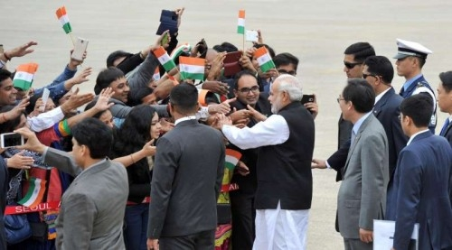 Prime Minister Narendra Modi greeted by the people on his arrival, at ROK Airbase, in Seoul, South Korea on May 18, 2015.