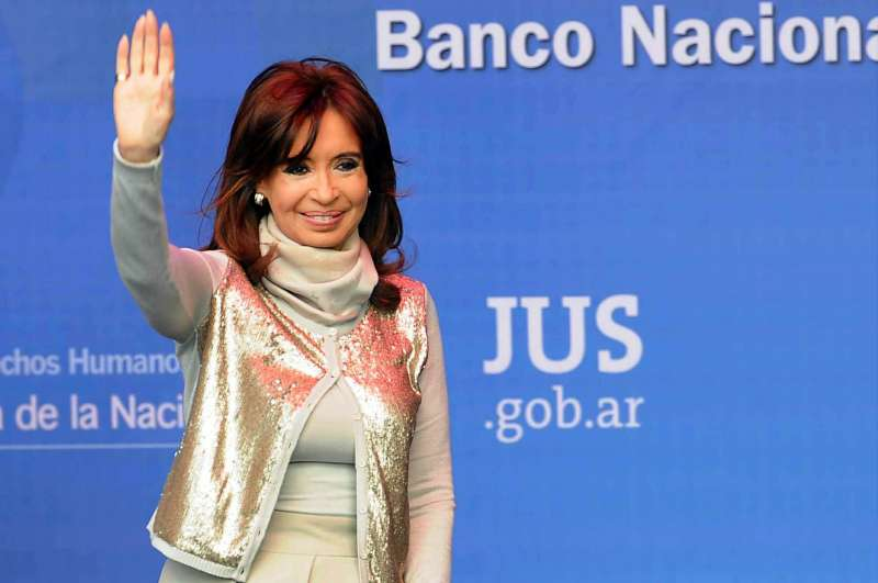 Argentina's President Cristina Fernandez waves upon her arrival at the inauguration ceremony of the new building of the National Bank of Controlled Materials and the National Register of Weapons in Buenos Aires, Argentina