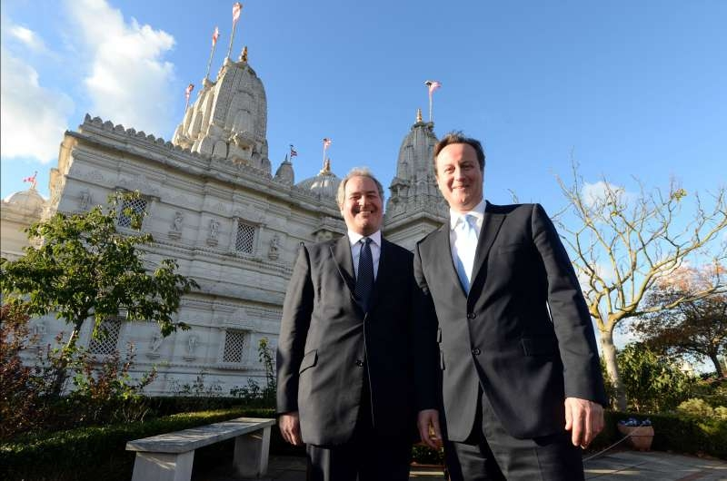 Bob Blackaman with Prime Minister David Cameron at Neasden temple