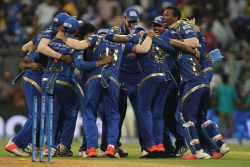 Caption: Mumbai: Mumbai Indians celebrate after wining the first qualifier match of IPL 2015 against Chennai Super Kings at Wankhede Stadium in Mumbai on May 19, 2015