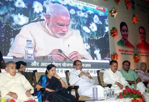 Union External Affairs Minister Sushma Swaraj during a programme to launch Prime Minister Narendra Modi`s three Social Security Schemes, ``Pradhan Mantri Jeeven Jyoti Bima Yojana``, ``Pradhan Mantri Suraksha Bima Yojana``, and ``Atal Pension Yojana``, in Bhopal on May 9, 2015. Also seen Madhya Pradesh Chief Minister Shivraj Singh Chouhan and BJP leader Kailash Joshi.