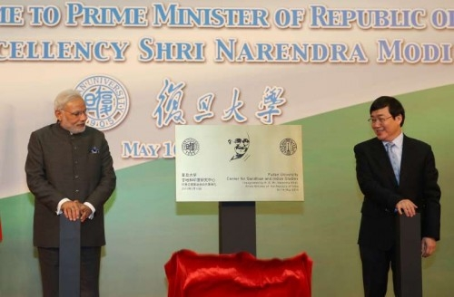 Prime Minister Narendra Modi (L) unveils a plaque with Xu Ningsheng, president of Fudan University, as he attends the inauguration for the Centre for Gandhian and Indian Studies at Fudan University in Shanghai, east China, May 16, 2015
