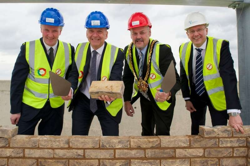 Dean of the Faculty of Social Sciences at the University of Wolverhampton Miceal Barden, Vice-Chancellor Professor Geoff Layer, Mayor of Wolverhampton Councillor Ian Brookfield and Simon Butler, Interserve Divisional Director lay the top brick of the new Lord Swraj Paul Building.
