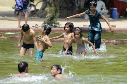 Children beat the heat in New Delhi.