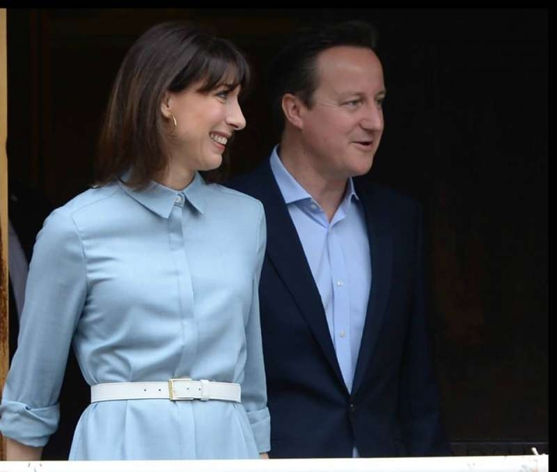 British Prime Minister David Cameron and wife Samantha on way to cast their vote