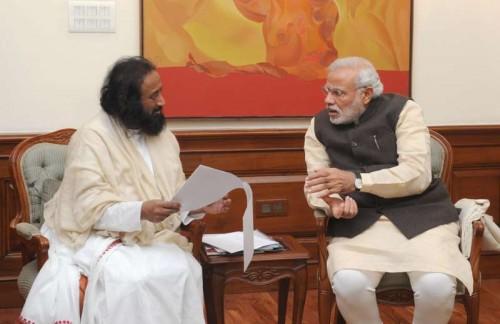 Sri Sri Ravi Shankar calls on the Prime Minister Narendra Modi, in New Delhi