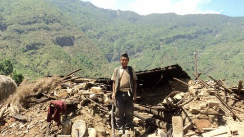 Ran Bahadur Gurung,74, stands amid the rubble which once was his home in a picturesque village of Gurkha.