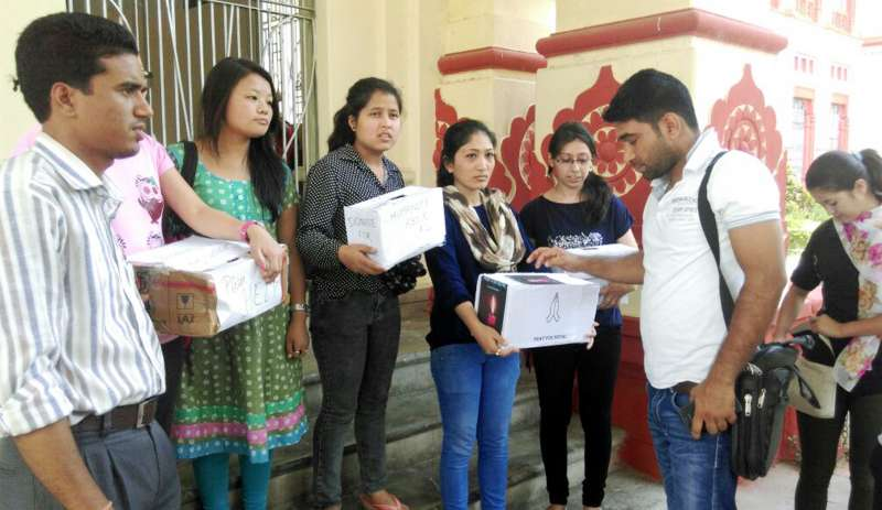 Nepali students of Banaras Hindu University (BHU) collect donations for the victims of Nepal earthquake outside the campus in Varanasi