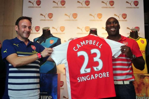 Former Arsenal player Sol Campbell (R) attends the Arsenal's new kit launch in Singapore