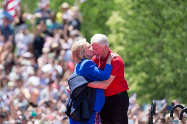 Hillary Clinton with husband President Clinton during a campaign trail