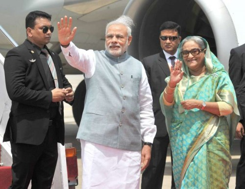 Prime Minister Narendra Modi being welcomed by the Prime Minister of Bangladesh, Sheikh Hasina on his arrival, in Hazrat Shahjalal Airport, Dhaka on June 06, 2015.