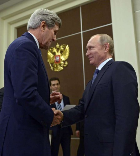 Russian President Vladimir Putin (R) shakes hands with U.S. Secretary of State John Kerry during their meeting in Sochi, Russia, May 12, 2015.